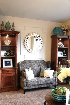 A SALTBOX: Living room, wall molding with framed in mirror.