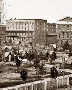 Atlanta, Georgia Trout House, Masonic Hall, and Federal encampment on Decatur Street. It was made in 1864