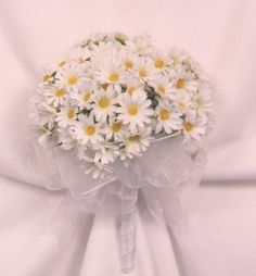 Daisy bridal bouquet. Would be lovely with just a simple, soft blue ribbon.  love