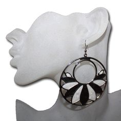 Flower earrings, flower ear rings, earrings flower.  These earrings give the illusion of stained glass. With the flower pedals colored with a swirling effect the Flower Haze Earrings are beautiful. They come in a variety of colors. Designed in the gold colored metal are the Orange, Green or Pink. Set in the silver colored metal are the Black, Teal or Purple.  You won't find a prettier Flower earring for such a cheap price. At only $1.25 each pair you won't want just one pair.