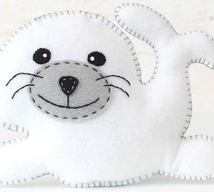 This listing is for a felt seal stuffed animal hand sewing pattern. ~~~o~~~o~~~o~~~o~~~o~~~o~~~o~~~ • This is a DIGITAL DOWNLOAD, not a PHYSICAL PRODUCT. You will not receive anything in the mail / by post. • You are welcome to sell personally-made finished products made from my