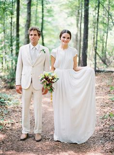So idk bout her dress and why she looks like Princess Leia but have always wanted my hubby to be in a white tux :)