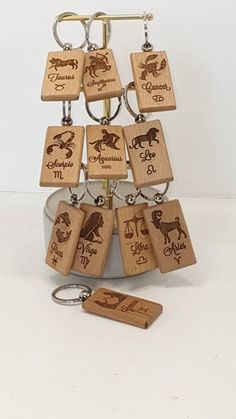 Star sign keyrings (zodiac keyrings) made from Beech wood with a swivel ball keyring. Wooden Words, Wooden Signs, Wood Burn Designs, Wooden Keychain, Wooden Ruler, Wood Images, Wood Burning Patterns, Wooden Projects, Pyrography