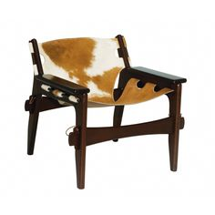 If you had to classify this chair based on materials alone you would call it exotic due to the dark, reddish wood and swath of cow-hide. But the construction looks just as raw. Stretchers are a common feature of chairs but these ones could pass for hand weapons. At the other extreme the seat is being supported with pegs as thin as pencils. By Sergio Rodrigues