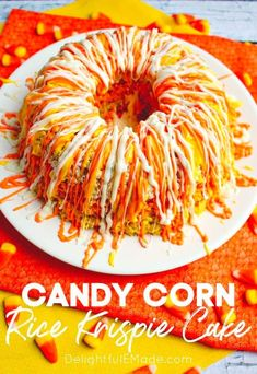 If you love candy corn, then this Candy Corn Krispie Cake is for you. It's layered to look like candy corn and drizzled with candy melts, this rice krispie cake makes the perfect fall treat! || Delightful E Made