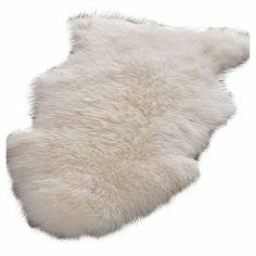 Handmade white sheepskin rug.   Product: RugConstruction Material: Sheepskin woolColor: WhiteFeatures: HandmadeNote: All sizes are approximate. Please be aware that actual colors may vary from those shown on your screen. Accent rugs may also not show the entire pattern that the corresponding area rugs have.Cleaning and Care: Professional cleaning recommended