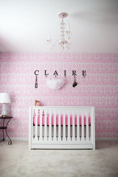 I love the idea of the name with letters as hooks...how clever. Not so keen on the black in a babies room though.
