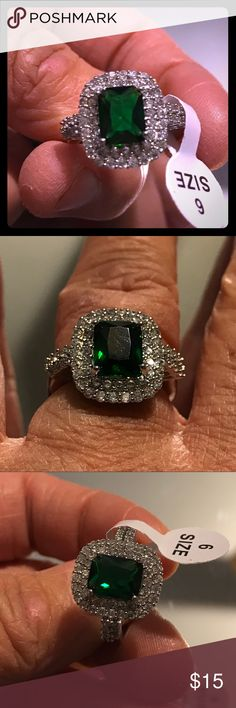 Brand New Emerald & CZ Ring Brand new silver ring with CZ diamonds and a large square Emerald. This 💍 is so beautiful.  The big emerald in the middle and the baby diamonds surrounding the ring, make it look extremely expensive. This ring is the perfect gift for that someone special.  ❤️ Part of the Pick (3) for $25.00. Jewelry Rings