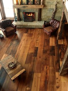 Love the wood floor-looks like reclaimed planks and off sets the stone FP