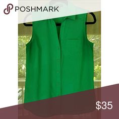 Green sleeveless collared tank Green sleeveless tank. Front pocket. Full button up. J. 100% polyester. Extra button on tag. The Limited Tops