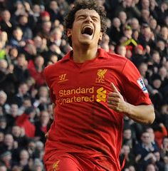 Philippe Coutinho marked his full debut with a goal as Liverpool returned to winning ways in emphatic fashion with a 5-0 rout of Swansea City at Anfield.
