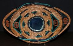 """This beautiful pine needle basket is 15.5"""" x 9.5"""". It has blue and teal accent stitching with blue and teal coils. The blue agate is 3.75"""" x 4"""" at it's tallest and widest points. It is also embellished with black walnuts."""
