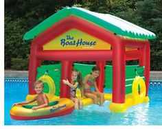 Everybody Loves Hangin'Out At The BoatHouse!  Complete with inflatable boat, buoy rings, and removable roof raft.