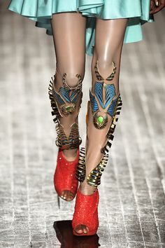 MANISH ARORA, RUNWAY-READY-TO-WEAR, SPRING 2011: Greaves, they are metal and on lower legs.