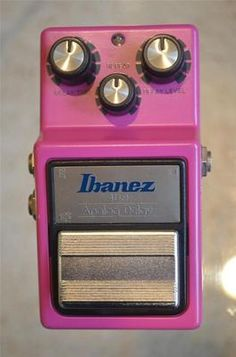 Ibanez AD-9. Lurid magenta, like its competitor, the Boss DM-2, with the same legendary Bucket Brigade Delay chip. Original ones used a 4096-stage BBD; the current re-issues use cascades of 1024-stage BBD's.