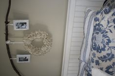 just redid over our bed with a burlap wreath that i am seeing all over the place!  and yes, i used a branch from my back yard...hubby thinks i'm crazy too :)