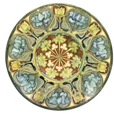 A DELLA ROBBIA POTTERY WALL PLAQUE -  DECORATED BY CASSANDIA ANN WALKER AND GERTRUDE RUSSELL, CIRCA 1900