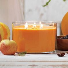 """Pumpkin Apple Cider 3-Wick Jar  The 3-Wick Scented Jar Candle is a PartyLite favorite! The three wicks create a generous pool of liquefied wax for the greatest fragrance throw. Enjoy our Pumpkin Apple Cider fragrance – a delightful fall treat of fresh apples and rich pumpkin with a dash of cinnamon and nutmeg. 3""""h, 4½""""dia. Burn time: 35-55 hours."""