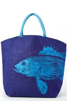 "This brilliant cobalt blue jute tote in coated inside for waterproofing. The perfect bag for a day at the water, a picnic or just a day of fun. Roomy enough for a full day and an interior pocket for small valuables . Handles are long enough to carry by hand or over your shoulder. The lighter blue printed fish begins on the front and ends on the back.    Measures: 17"" H x 21"" L x 8"" W    Blue Fish Tote by The Purple Porch. Bags - Totes Tennessee"