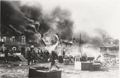 Buildings burning in a fire, possibly set during a pogrom, which destroyed most of the town. Postcard sent by Leib Shafer to relatives in America. Plunge, April 2, 1931.