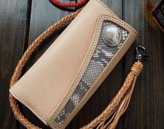 Overview: Design: Handmade Leather Biker Wallet Boa Skin Trifold Mens Cool Chain Wallet Trucker Wallet with ChainIn Stock: Ready to Ship (2-4 days)Include: Onl