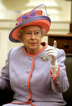 Inside the old Senate chamber in Virginia, Queen Elizabeth II makes a point with her pastel purple and hot orange attire for the commemoration of Jamestown's 400th anniversary.