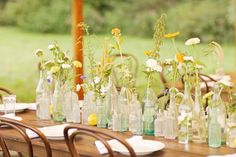 tablescape with assorted medicine bottles and glass.  such a statement!