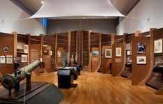 Amsterdam/New Amsterdam exhibition wood paneling reminiscent of the hull of a ship