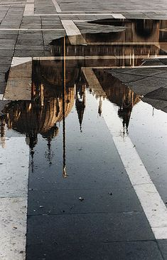 There's nothing quite like seeing Europe when it rains, and then seeing it anew in the artery reflections that are left behind.