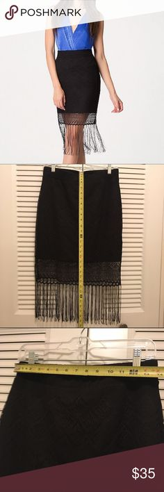 Fringe and lace Bebe skirt  black Large Gorgeous fitted skirt perfect for dancing with a feminine mesh border-lace overlay and sexy Spanish fringe. Stretch waist. No closures. Used very good condition. bebe Skirts Midi