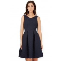 This cute high v neckline dress with navy jacquard detailing cinches in the waist and has a structured box pleated skirt which adds a playful edge. We are wearing ours with wedges for  an effortless day to night outfit.