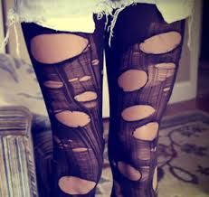 DIY distressed tights. Cut small horizontal incisions down the front and/or back length of the tight. This is easier to do while you are actually wearing them. You can stretch the incisions to varying widths, and you can also create a shredded look by pulling up vertically on the raw edges to create runs in the stocking. The more you play with the fabric the more of a distressed look you can achieve. Play around with different fabrics and densities for a variety of looks.
