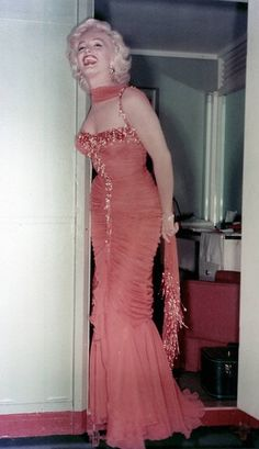Someone could make me this?! ZOMG. Marilyn Monroe's Orange Gentlemen Prefer Blondes dress, via Etsy.