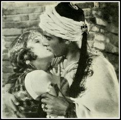 Rudolph Valentino kisses Vilma Banky in 'The Son of the Sheik' - Photoplay Jul 1926