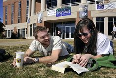 WCU students enjoy the warm weather between classes out on the UC lawn.