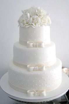 Three tiered white wedding cake. A classic of all classics. Elegance & style.