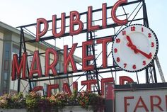 Public Market Sign: pike-place-market-sign Notice the flowers at its base!