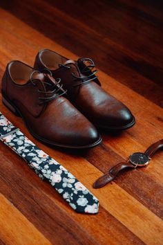 Simple yet strong accessories for your future husband. Handsome elegant wrist watch with tan brown shoes with a floral tie that brings everything together. Tan Brown Shoes, Groom Accessories, Cape Town, Future Husband, Floral Tie, South Africa, Oxford Shoes, Dress Shoes, Handsome