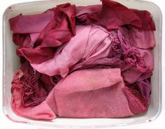 natural dyeing with blackberries  Various natural fabrics, cotton, silk and threads in a dye bath of blackberry juice