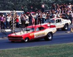 """Pee Wee Wallace and his """"The Virginian"""" Funny Car up against Bruce Larson with his USA-1 funny car. Description from ebay.com. I searched for this on bing.com/images"""