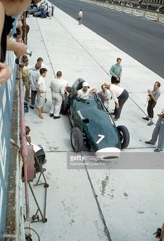 The German Grand Prix, Nürburgring, August 3, 1958. During practice Stirling Moss informs team owner Tony Vandervell (in straw hat) how…
