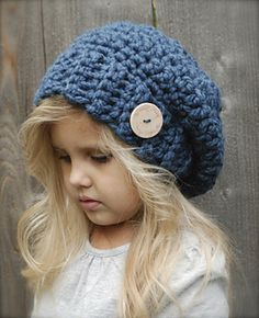 Ravelry.com  tons of adorable crochet patterns! Slouchy hats, cowl neck scarfs, hoods, etc...