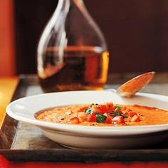 Tomato-Basil Soup If you wish, pass the cheese, cream, Armagnac, and the tomato-basil mixture at the table and let guests add the ingredients to their liking in this easy soup recipe.