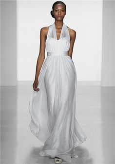 Satin faced chiffon halter neck gown with full sweeping skirt.