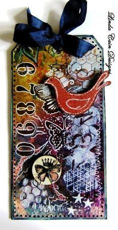 Absolutely amazing tag by Linda Cain - so artsy and rich with details! (Just like all her other creations, of course!)