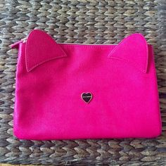 """Betsey Johnson Pink, Leather, Clutch w/ Cat Ears!! Super Cute, Betsey Johnson Bag! NWOT!Beautiful, Pink, Leather-The Front has 2 Cat-Ears attached & a small gold  w/ """"Betsey Johnson"""" on it. Gold Zipper. Lining the inside of the bag, is a Gorgeous, Satiny, Material that is Black w/ Vivid, Colorful, Flowers. Measuring 10x6.5"""" the bag is an ideal size to use for Anything! Use it as a Clutch to Spice up any outfit, A makeup bag that fits all, Use it to stay organized when u travel, Protect ur…"""