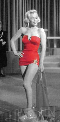 Marylin Monroe in red swimsuit - I love how the color red was added in this photo