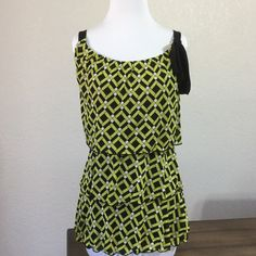 Awesome Top Worn only once you'll love the style comfort and fit.  It does have stretch to it and you'll love it for any occasion.  No rips or stains worn once.  Great brand at a great price.  Has great coverage in aLl the right places. This  is figure flattering very cool. True to size 😀 Style & Co Tops