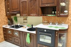 extensive use of wall space for kitchen cabinets helps to greatly increase the functionality of this small kitchen design