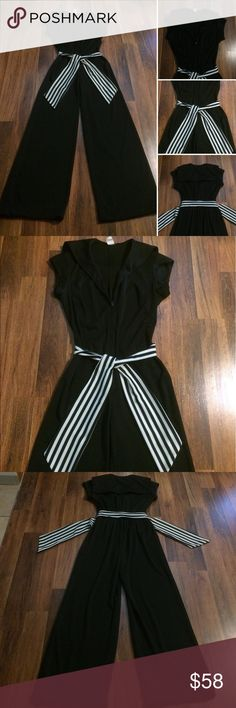 💫FIRM. Very Rad Vintage 70s Jumpsuit Refer to pictures for description and measurements. No designer label with a size. Polyester. Will list as a Medium. Refer to measurements provided. Was Deadstock when I bought it. Worn and washed once. Small hole starting on crotch seam. Tugged at a thread. Ugh! Easy fix. Elastic back. Awesome 70s jumpsuit. Pretty Firm on price. Please ask any questions before purchasing. Thank you Vintage Pants Jumpsuits & Rompers